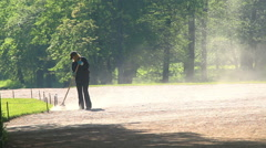 Woman the worker sweeps in park. St. Petersburg. Russia. 2015 Stock Footage
