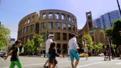 Stock Video Footage of People crossing the street near Vancouver Public Library Building