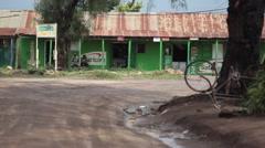 Tribal people on street in Maralal Samburu County, Kenya, Africa, long shot Stock Footage