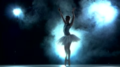 Graceful ballerina doing a workout in the classroom Stock Footage