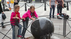 Girls twist a stone sphere.  St. Petersburg. Russia. 2015 - stock footage