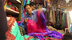 Dealer of fabric in the Indian shop shows goods. Maunt Abu.2014 Stock Footage