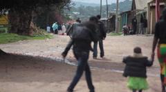 People walk on poor street in Africa town of Maralal, Samburu, Kenya Stock Footage