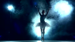 Ballet dancer posing on a studio background, slow motion Stock Footage