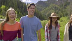 Friends Walk Through Field Together In The Mountains Of Utah (Slow Motion) Stock Footage