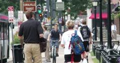 Busy sidewalk on college campus - 4k - Iowa City Stock Footage