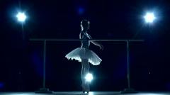 Ballerina standing near barre, slow motion Stock Footage