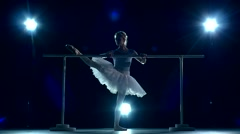 Ballerina is wearing in white dress and pointe shoes. slow motion Stock Footage