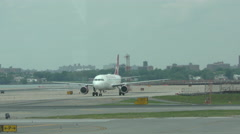 Virgin Airlines jet taxiing Stock Footage