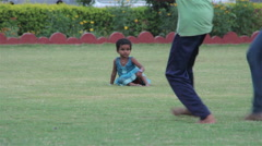 Indian little girl watch game in soccer on the park. Delhi. India. 2015 Stock Footage