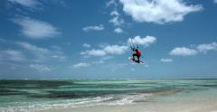 Kite boarding, jump over the camera. - stock footage