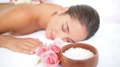 Woman enjoying a herbal compress massage Stock Footage
