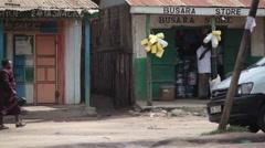 Old woman walking home in poor Africa town, Maralal, Samburu, Kenya Stock Footage