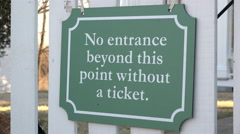 Ticket required beyond this point sign hanging on gate 4k Stock Footage