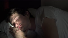 Man waking up with sunlight on his face 4k - stock footage