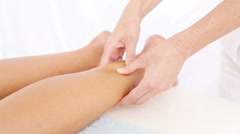 Physiotherapist doing a foot massage - stock footage