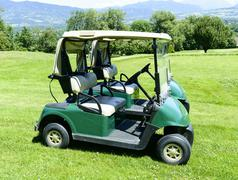 two green golf cars - stock photo