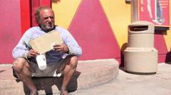 Man holding blank sign needing help in Las Vegas 4k Stock Footage
