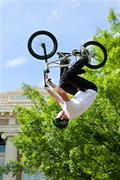 Pro Rider Flips Upside Down In BMX Bike Competition - stock photo