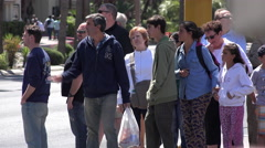 People waiting to cross intersection at light 4k Stock Footage