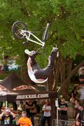 Pro Rider Gets Upside Down Performing BMX Trick In Competition Stock Photos