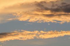 Orange And Yellow Colors Sunset Sky. Sunlight through clouds - stock photo