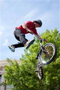 Teenager Performs Midair Stunt In Pro BMX Bike Competition Stock Photos