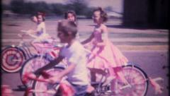 2268 - children decorate their bikes for a parade - vintage film home movie Stock Footage