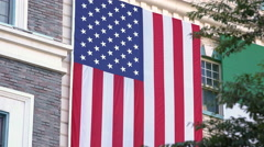 American Flag hanging proudly on building 4k - stock footage