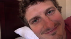Close up of male face looking at camera lying in bed 4k Stock Footage
