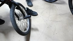 BMXers close up wheels preparing to ride - Extreme Sports Stock Footage