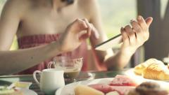 Woman hands using smartphone and eating watermelon on terrace HD - stock footage