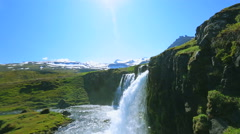 Beautiful Waterfall with Blue Sky and Green Grass. Stock Footage