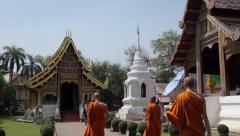 Monks in buddhist temple in Chiang Mai, Thailand. - stock footage