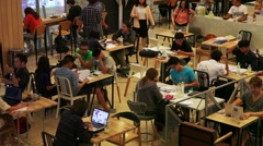 Asian students group studying & working together in cafe area Stock Footage