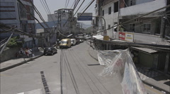 Vehicles moving on street in Rocinha - stock footage