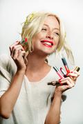 Stock Photo of Cute Model with Makeup Applying Lipstick