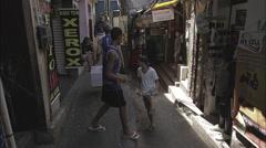 People walking in favela - stock footage
