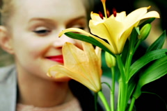Young girl smelling beautiful flower  Stock Footage