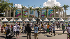 Tourists near entrance of Maracana Stadium to attend FIFA World Cup - stock footage