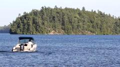 Motorboat across a blue lake - stock footage