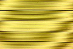 abstract of line up yellow metal slat for background used - stock photo