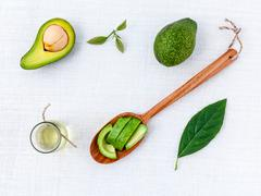 Avocado oil on the white table background clean and healthy concept. Stock Photos