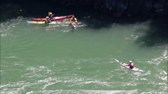 Four Kayakers join up on the water Stock Footage