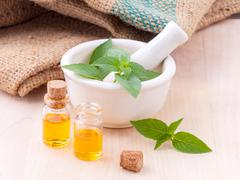 Alternative medicine lemon basil oil natural spas ingredients for aroma aroma Stock Photos