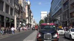 ULTRA HD 4K Bustling Oxford commercial street London crowded traffic street taxi Stock Footage