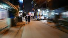 Night street walk timelapse, modern slum area, motion blur Stock Footage
