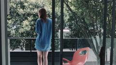Woman enjoying black tea in balcony Stock Footage