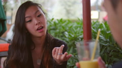 A young woman laughing out loud on a lunch date Stock Footage