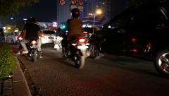 Busy traffic night street low angle, horn signal, junction traffic light Stock Footage